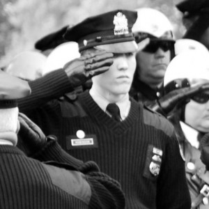 Philadelphia Police Officer James Robinson salutes the casket of fellow police officer Sgt. Simpson. Photo courtesy of James Robinson.