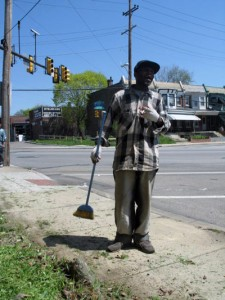 Longtime Logan resident Eric Turner cleans a sidewalk along 16th and Loudon streets. Turner said keeping his neighborhood clean is important in order to improve the quality of life for his neighbors.