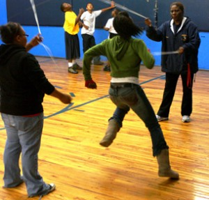 Officer Wells helps with some double dutch.