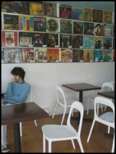 A patron of MilkCrate Cafe browses the Internet