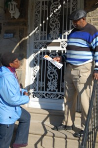 Margaret Shepherd gives passes out delinquency information to residents of West Oak Lane